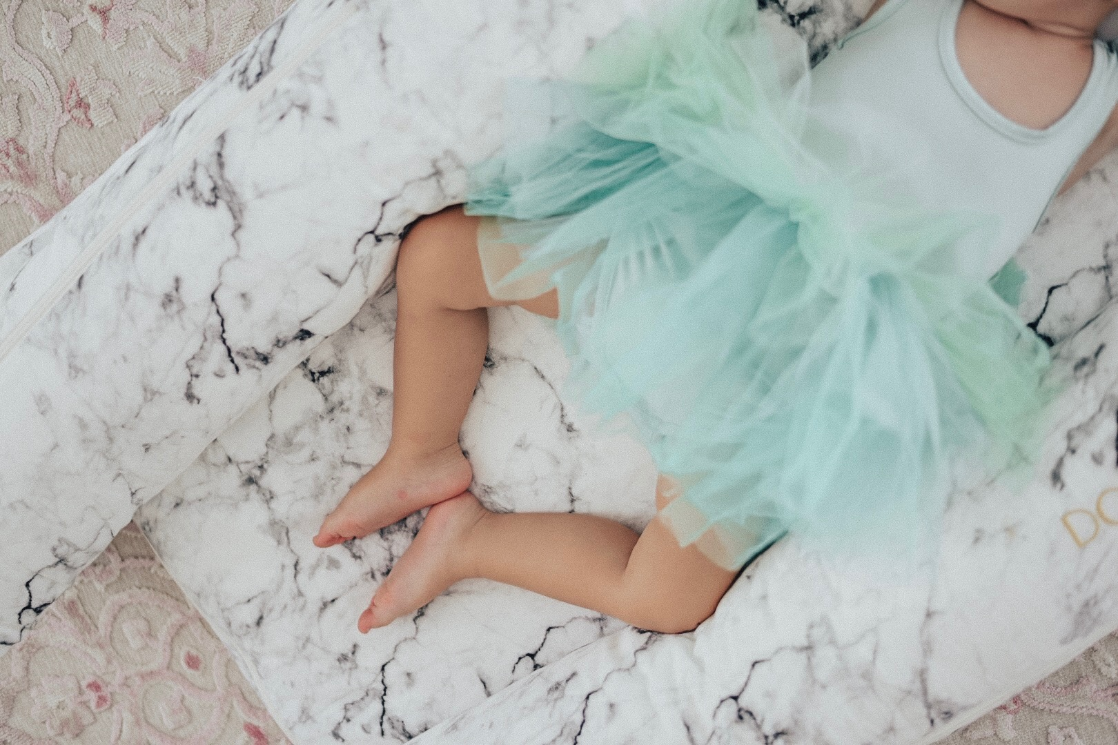 Matilda napping comfortably on the floor of her nursery.
